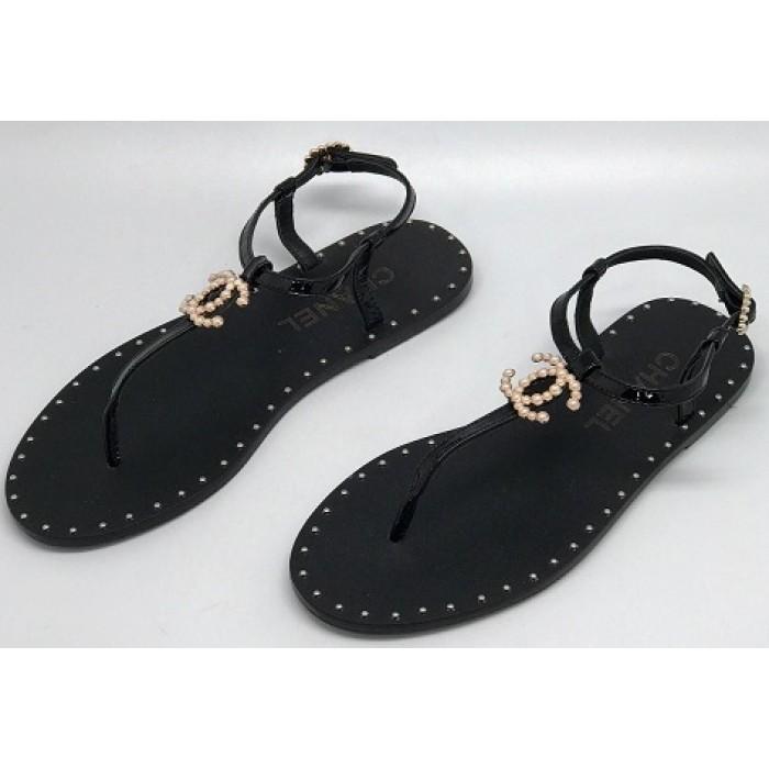 58cfa71bbf59 Эксклюзивная брендовая модель Женские брендовые кожаные сандалии Chanel  Cruise черные на плоской подошве