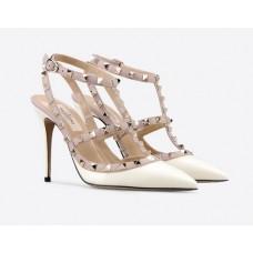 Женские белые лакированные туфли Valentino Garavani Rockstud